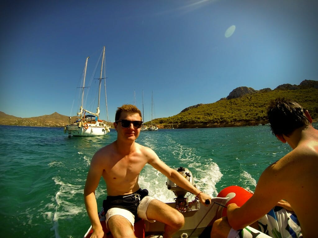 At the helm - in small groups we explored the coastline of the island in dinghies